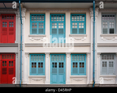 Colorful shophouse window shutters on Bukit Pasoh Road, Chinatown, Singapore - Stock Image