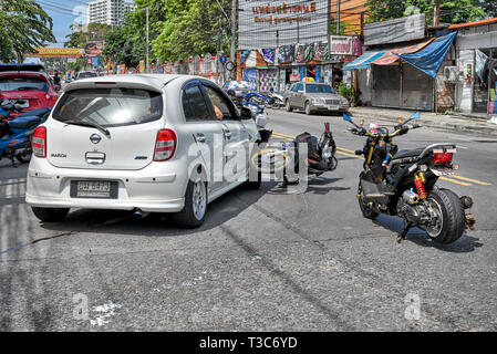 Road accident involving a car and a motorcycle. A very common sight on Thailand's roads known as the worlds no 1 for road deaths. - Stock Image