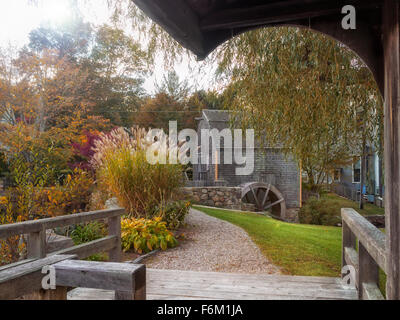 Dexter Grist Mill, Sandwich, Cape Cod Massachusetts USA with undershot wooden water wheel and millrace in autumn - Stock Image