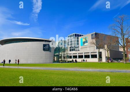 Amsterdam, Netherlands - April 2019; Museumplein on a bright spring day. Van Gogh museum. - Stock Image