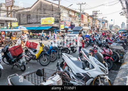 Phuket, Thailand 21st January 2019: Motorcycles parked outside the market in Phuket Town. The daily market is busy in the mornings. - Stock Image