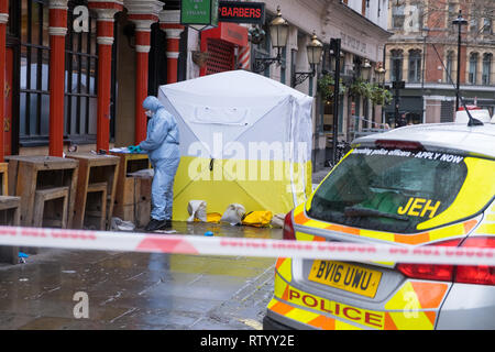 Soho, London, UK - March 3, 2019: A forensic officer at the crime scene outside in Romilly Street in Soho. Credit: michelmond/Alamy Live News - Stock Image