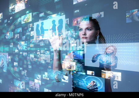 Young woman using futuristic interface. IoT(Internet of Things). ICT(Information Communication Network). Social - Stock Image