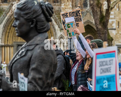 London, UK. 15th Mar 2019. Protesting around the statue of Sufragette Millicent Fawcett - School students go on strike over the lack of action on climate change. They gather in Parliament square and march on Downing Street, blocking the streets around Westminster for over an hour. Credit: Guy Bell/Alamy Live News - Stock Image