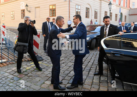 Czech PM Andrej Babis, left, welcomes his Polish counterpart Mateusz Jakub Morawiecki at the meeting of prime ministers of the Visegrad Four (V4) states (Czechia, Hungary, Poland, Slovakia) to discuss Visegrad Group stances before special meeting of European Council to be held on June 30 in Brussels, in Prague, Czech Republic, on Friday, June 28, 2019. (CTK Photo/Michal Kamaryt) - Stock Image