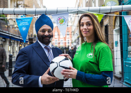 London, UK. 18th March, 2019. Ranjit Baxi, Founding President of the Global Recycling Foundation, and Taekwondo World Champion Samira El Idrissi prepare to take part in the Recycling Goals football challenge to mark the celebration of the second annual Global Recycling Day. The challenge is a social media movement that harnesses the power of football to inspire long term recycling habits in young people across the world. Credit: Mark Kerrison/Alamy Live News - Stock Image