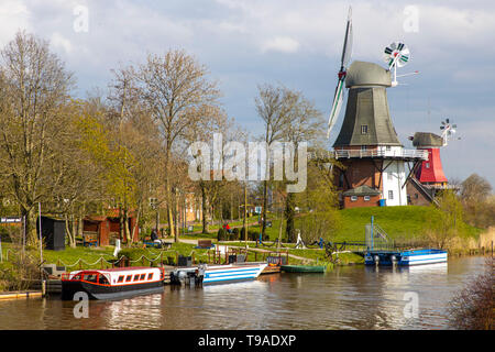 Greetsiel village, municipality Krummhšrn, Historical old town, Twin mills, windmills, canal, East Frisia, Lower Saxony, Germany, - Stock Image