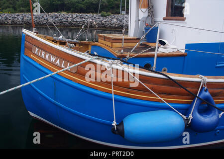 A newly refurbished timber boat beautifully restored and painted a deep blue showing details along on side of the boat - Stock Image