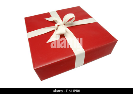 A wrapped present with red paper and a ribbon bow on a white background. - Stock Image