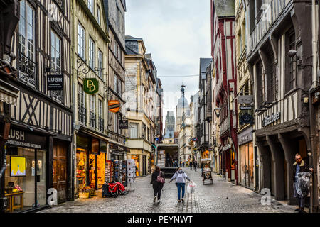 Morning on the main street Rue du Horloge in the medieval town of Rouen, France as deliveries are made and and locals head to work in the tourist area - Stock Image