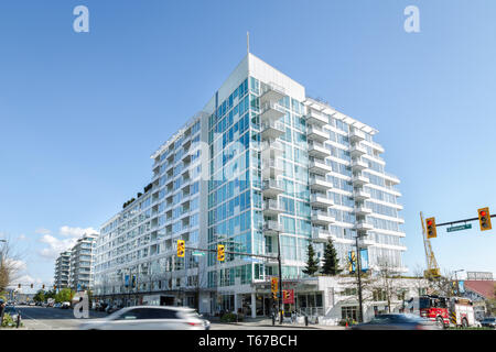 NORTH VANCOUVER, BC, CANADA - APR 26, 2019: New developments built on Esplanade Ave as part of the continued construction boom in Vancouver. - Stock Image