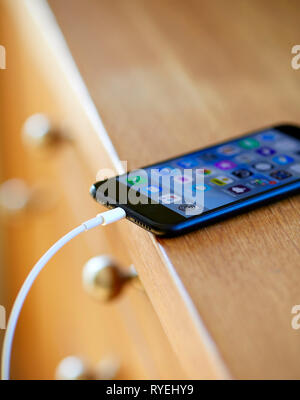 Mobile phone on charge - Stock Image