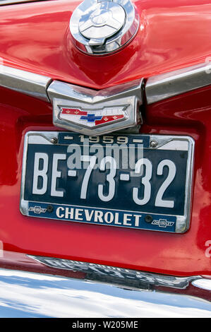Detail of a Dutch number plate on a red 1959 Chevrolet car - Stock Image