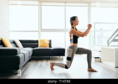 Adult Woman Training Legs Doing Inverted Lunges Exercise - Stock Image