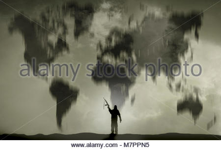 Terrorist brandishing gun in front of world map - Stock Image