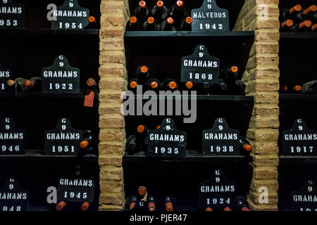 Graham's Port Lodge, Vila Nova de Gaia, Porto, Portugal, showing bottles of port from the year 1868. - Stock Image
