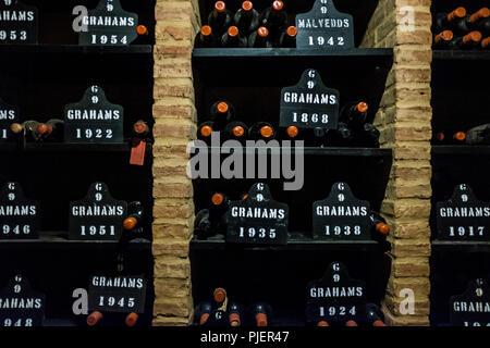 Graham's Port Lodge, Vila Nova de Gaia, Porto, Portugal, showing bottles of port from the year 1868. - Stock Image