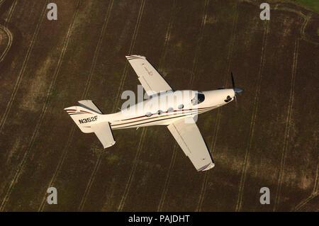 Farnborough F1 Kestrel prototype flying over fields - Stock Image
