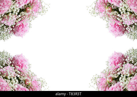 Flower composition. Frame of pink flowering bouquets of Peonies and Baby's Breath flowers over a white background  with free space for your text. - Stock Image