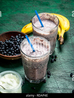 Fresh berry smoothie. On rustic background - Stock Image