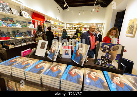 Visitors in the Museu Picasso Malaga gift shop , Picasso Museum, Malaga Spain - Stock Image