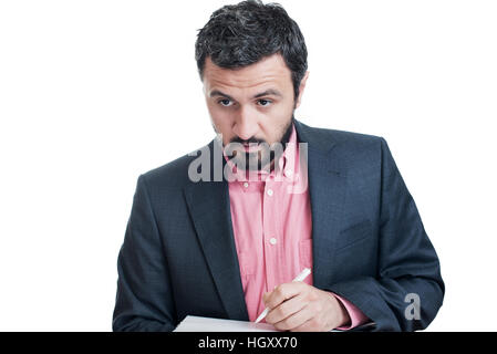 Portrait of a grey hair man with beard, working at home on some project - Stock Image
