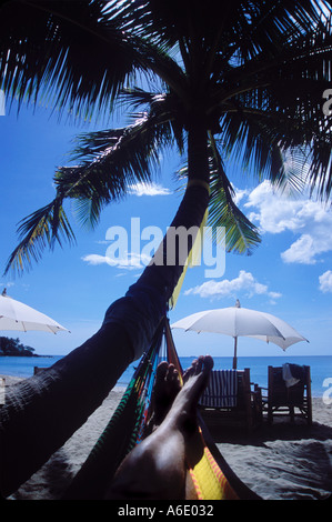 Lying in Hammock on beach Koh Lanta Thailand - Stock Image