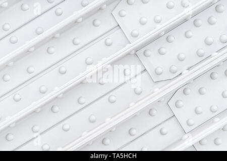 White heavy steel construction close up. Industrial texture and background - Stock Image