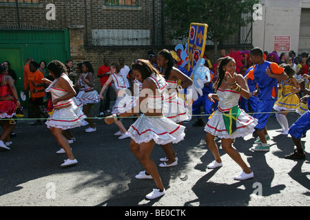 Young Caribbean Girls Dancing in the Notting Hill Carnival Parade 2009 - Stock Image
