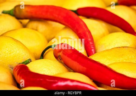 Close up shot of some chili peppers and lemons - Stock Image