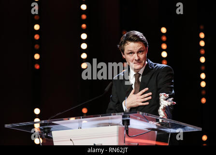 Berlin, Germany. 16th Feb, 2019. Cameraman Rasmus Videbaek receives the Silver Bear for Outstanding Artistic Contribution award for 'Out Stealing Horses' during the awards ceremony of the 69th Berlin International Film Festival (Berlinale) in Berlin, capital of Germany, on Feb. 16, 2019. Credit: Shan Yuqi/Xinhua/Alamy Live News - Stock Image
