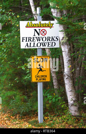 'No Fireworks Allowed' and 'Slow Children Playing' signs at an American campground. - Stock Image