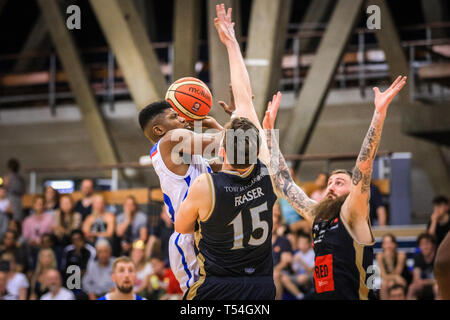 London, UK, 20th April 2019. Royals' Wes Washpun (20) finishes off a point. Tensions run high in the London City Royals v Glasgow Rocks BBL Championship game at Crystal Palace Sports Centre. Home team LCR win the tight game 78-70. Credit: Imageplotter/Alamy Live News - Stock Image