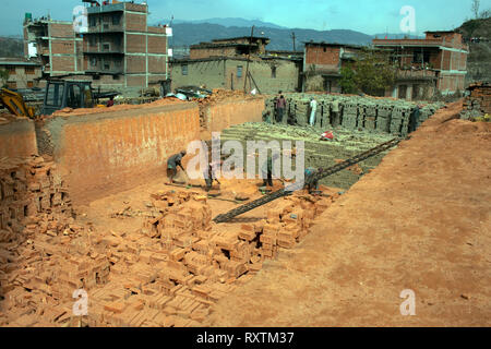 Demand for bricks is high as Nepal recovers from the 2015 earthquake. Bhaktapur, Nepal. - Stock Image