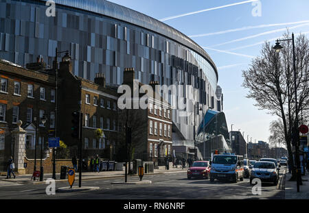 Tottenham London UK February 2019 -  The new Tottenham Hotspur Stadium towers above the surrounding buildings including Percy House in the High Rd - Stock Image