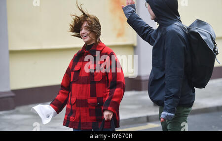 Brighton, UK. 12th Mar, 2019. Its hair raising for visitors walking in Brighton as Storm Gareth arrives in Britain and Ireland with wind speeds forecast to reach up to 70 mph in some areas Credit: Simon Dack/Alamy Live News - Stock Image