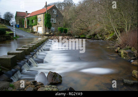 The ford and stepping stones crossing Eller Beck in Goathland, North York Moors National Park - Stock Image