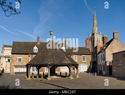 The Old Butter Cross, Oakham School buildings and tower of All Saints Church seen from the market place, Oakham, Rutland, England, UK. - Stock Image