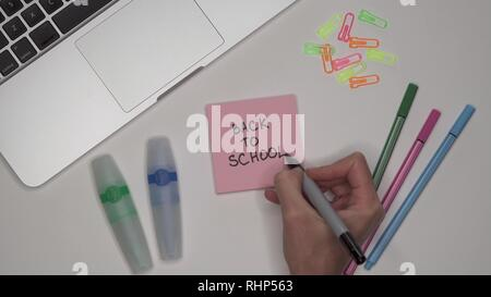 School concept. BACK TO SCHOOL on notepad. School supplies and stationery on the desk - Stock Image