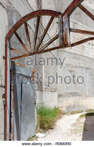 Rusty Lane Way Gate Wrapped in Barbed Wire - Stock Image