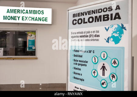 Cartagena Colombia Aeropuerto Internacional Rafael Nunez Airport inside concourse terminal customs immigration passport control Spanish language sign - Stock Image