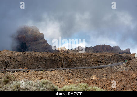 Landscape with road and volcanic lava fields on highest mountain in Spain Mount Teide, Tenetife, Canary Island, Spain - Stock Image