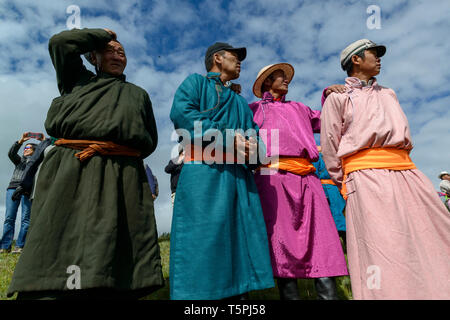 Naadam Festival in Khatgal, Mongolia. Spectators in their traditional garments - Stock Image
