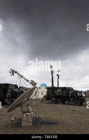 U.S. Soldiers with 5th Battalion, 7th Air Defense Artillery Regiment, 10th Army Air & Missile Defense Command install and check MIM-104 Patriot surface-to-air missile (SAM) systems for a readiness exercise at Oberdachstetten range complex, Ansbach Germany, March 13, 2019. - Stock Image
