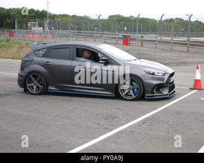 Ford Focus RS mk3 modified in grey on show at the RS OWNERS CLUB National day at donnington park race circuit - showing front and side view - Stock Image