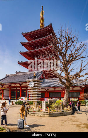 25 March 2019: Tokyo, Japan - The Five-Storey Pagoda and clocktower at Senso-ji Buddhist Temple, Tokyo. - Stock Image