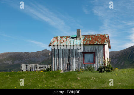 An old cabin close to the road at Stave, Andoya, Vesteralen, Norway - Stock Image