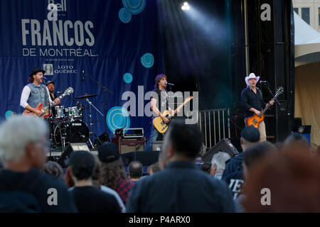 Montreal, Canada. 6/11/2018. iconic Quebec city band Les Respectables  perform on stage at the Francofolie French music festival in downtown Montreal - Stock Image