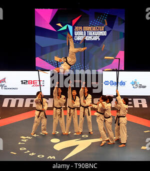 A Taekwondo demonstration team perform during the opening ceremony of the World Taekwondo Championships at Manchester Arena. - Stock Image