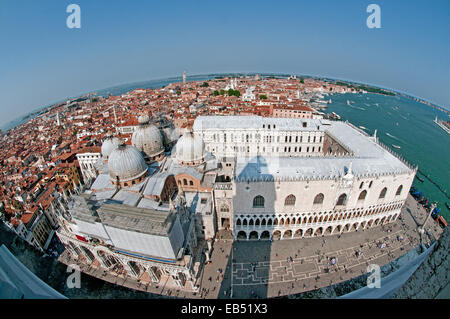 Fish eye lens view looking east from St Marks Bell Tower Venice Italy showing Basilica di San Marco Doges Palace - Stock Image